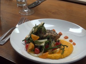 Roy's featured Localicious dish of herb-crusted fish with kabocha purée and pohole fern salad, which helps support ag education. Photo by Kiaora Bohlool.