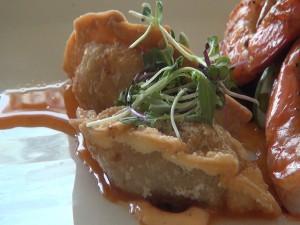 Chicken gyoza with firecracker sauce at Roy's Kā'anapali. Photo by Kiaora Bohlool.