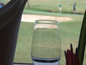Glass and golf at Roy's Kā'anapali. Photo by Kiaora Bohlool.