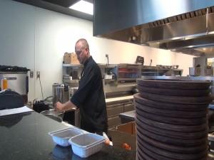 Chef Ferguson in Roy's open kitchen in Kā'anapali. Photo by Kiaora Bohlool.