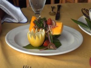 Fresh papaya with pohole fern and onion, part of the Hawaiian diet meal at KBH's Tiki Terrace restaurant. Photo by Kiaora Bohlool.