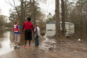 Wednesday March 16, 2016. McClain, Mississippi. Red Cross volunteers Lil Doody and Fran Walker console Davrion Hartfield, a resident of McClain, MS as they look out on flooded homes. Photo by Shannon Toombs/ American Red Cross