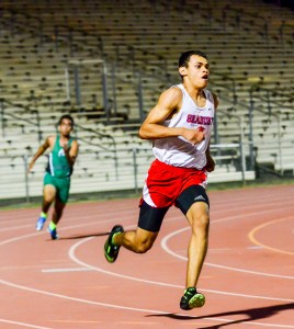 Seabury Hall's Isaiah Payne won his heat of the 100, 200 and 400 on Friday at MIL Meet #3. Photo by Rodney S. Yap.