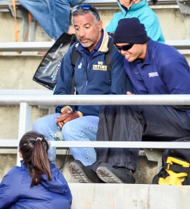 Kamehameha Maui head coach Ruby Huber (top left) and assistant coach Jason Bisera talk to one of their jumpers on the sidelines. Photo by Rodney S. Yap.