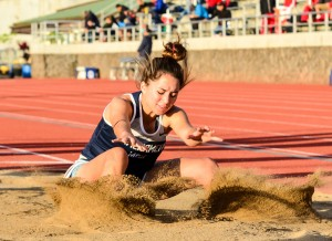 Kamehameha Maui's Quinn Williams lands into the girls long-jump pit safely. Photo ny Rodney S. Yap.