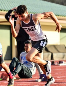 A Kihei Charter runner explodes out of the starting blocks in the boys 100-meter dash. Photo by Rodney S. Yap.