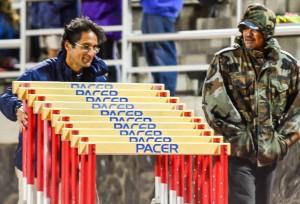Kamehameha Maui's Leo Delatori and Nelton Waikiki help with the 300 hurdles Friday at the Kamehameha Maui Relays. Photo by Rodney S. Yap.