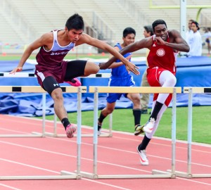Baldwin's Kiernan Leighton Mateo wins the boys 110 high hurdles with a new personal best time of 14.71 seconds. Photo by Rodney S. Yap.