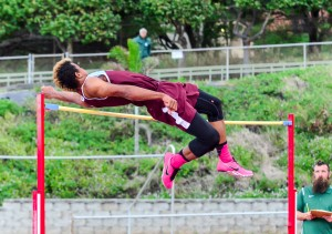 Baldwin's La'akea Kahoohanohano-Davis clears the high jump cross bar at 6 feet 6 3/4 inches on his first try Saturday. The winning height was a new meet record. Photo by Rodney S. Yap.