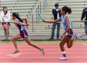 Baldwin's winning 4 x 100 relay execute the first handoff Saturday. Photo by Rodney S. Yap.