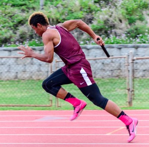 Baldwin's La'akea Kahoohanohano-Davis explodes out of the starting blocks running the first leg of the boys 4 x 100 relay. Photo by Rodney S. Yap.