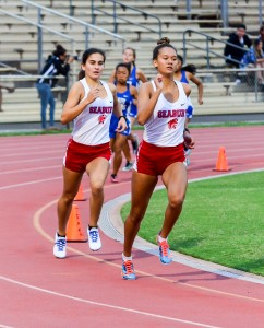 Seabury Hall's Ava Shipman leads teammate Veronica Winham in the girls 800 Saturday at the Yamamoto Track & Field Facility. Photo by Rodney S. Yap.
