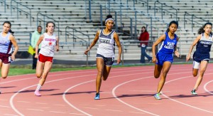 Kihei Charter's Maya Reynolds leads at the turn of the girls 200 Saturday. Photo by Rodney S. Yap.