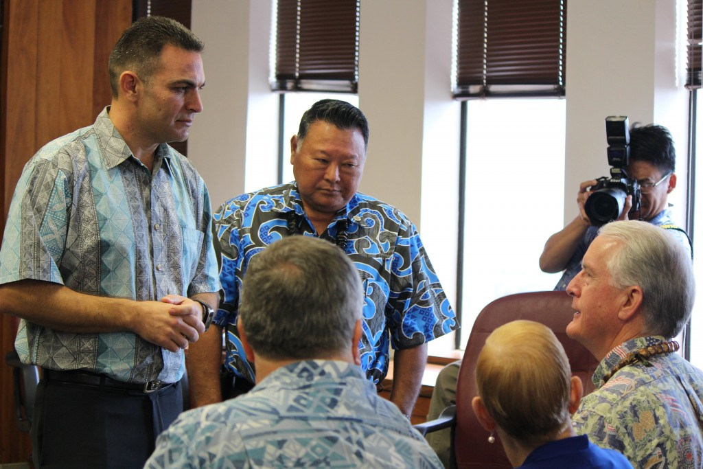 Budget Director Sandy Baz (left) and Maui Mayor Alan Arakawa (right) speak with council members Don Couch, Gladys Baisa and Mike White as they present the Mayor's version of the 2017 Fiscal Year budget to the council. Photo (3.24.16) by Wendy Osher.