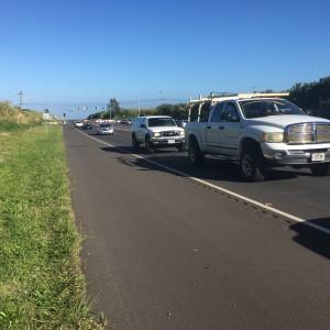 Haleakalā Highway looking makai. Police are seen diverting traffic onto Makani Road in the distance. Traffic accident/Road closure, 3.30.16. Photo by Debra Lordan.