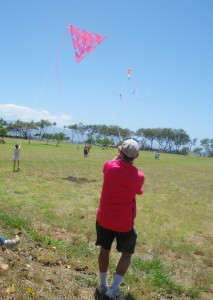 Robert Loera flies large tetrahedral kite made by Lahaina's Kite Festival participants during last year's event while participants fly their own kites on kite flying day. Photo courtesy of Lahaina Restoration Foundation