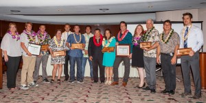 2016 Small Business Award Winners photo, Maui County: (left to right) Teena Rasmussen; Dennis and Shaun Walsh of Skullbase; Caroline Killhour of Hui No'eau Visual Arts Center; Cody Christopher, Travis Morrin and Jaron Blosser of Three's Catering LLC dba Three's Bar & Grill; Mayor Alan Arakawa; Cheryl and Michael Rock of Mele Ukulele; Pam Tumpap; David Tucker and Robert Campbell of Maui Printing Company Inc.; and Jonathan Miller of eDesign Group, Inc.