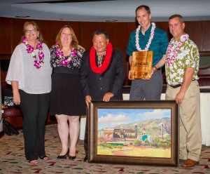 Mayor's Office of Economic Development Directo Teena Rasmussen; Maui Chamber of Commerce President Pamela Tumpap and Mayor Alan Arakawa present the Legacy Award for Small Business Support to HC&S. (Second from right) Alexander & Baldwin President & CEO Christopher Benjamin and (far right) HC&S General Manager Rick Volner also received an original oil painting by artist Michael Clements. Maui County photo.
