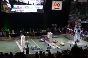 Alliances comprised of three robots each compete on the game field during qualification matches at the Hawaii FIRST Regional Competition at Stan Sheriff Center on Oahu, April 1-2, 2016.