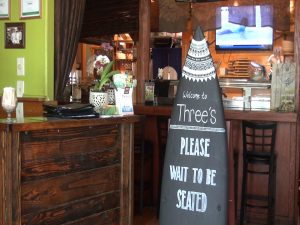 Surf-themed entry at Three's Bar & Grill. Photo by Kiaora Bohlool.