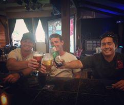 The three friends behind Three's celebrate in their restaurant. Courtesy photo.