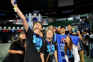 A jubilant Baldwin robotics team take a group selfie after snagging the regional title at the 2016 Hawaii FIRST Regional Competition.