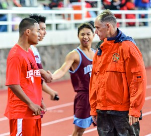 Allan Fernandez talks with a Lahainaluna athlete following the boys 400 meters at a recent track meet at Kamehameha Schools Maui. Photo by Rodney S. Yap.