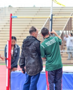 Allan Fernandez oversees the measuring of the high jump bar with a Maui Prep Academy coach. Photo by Rodney S. Yap.
