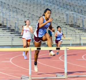 Baldwin's Kacy-Lyn Navarro won four events last week and the Kamakea Meet. She was named the meet's top female field performer for his wins in the long jump and triple jump. But she also won the girls 100 and 300 hurdles. Photo by Rodney S. Yap.