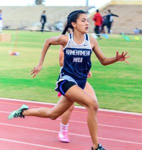 Kamehameha Maui's Ani Nitta en route to winning the girls 100 and 200 Friday at the Yamamoto Track & Field Facility. Photo by Rodney S. Yap.