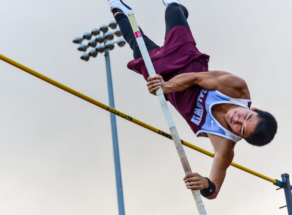Baldwin's Sean Fukuhara goes over the pole vault crossbar at 14 feet last week at MIL Meet #4. He is the state's top-ranked vaulter at 14-7. Photo by Rodney S. Yap.