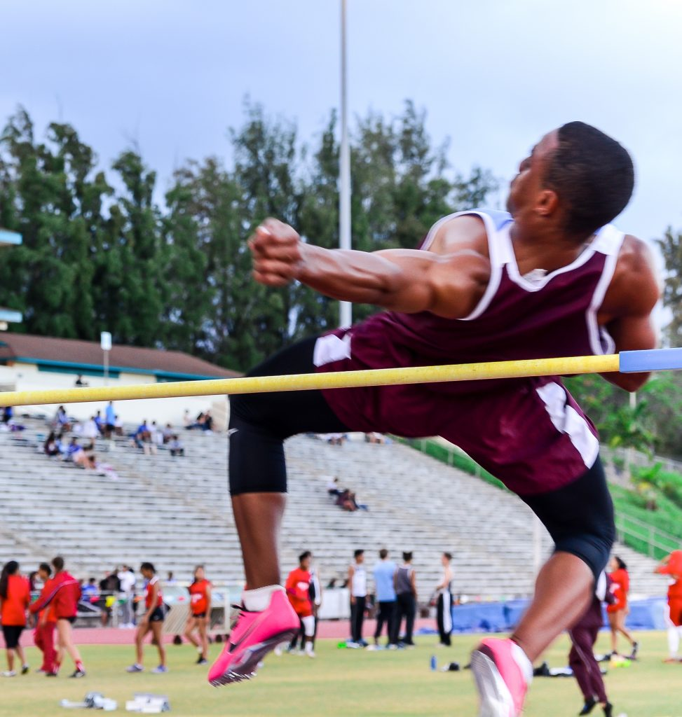 Baldwin's La'akea Kahoohanohano-Davis clears the high jump bar at 6-foot, 4-inches at last week's MIL Meet #4. Photo by Rodney S. Yap.