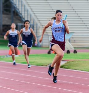 Baldwin's Kaitlin Smith anchors the Lady Bears' 4x100 relay to victory Friday. Photo by Rodney S. Yap.