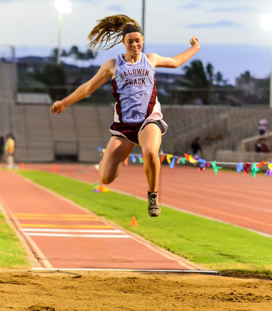 Baldwin's Kaitlin Smith en route to one of two meet records she set in Friday's trials of the MIL track and field championships. Photo by Rodney S. Yap.