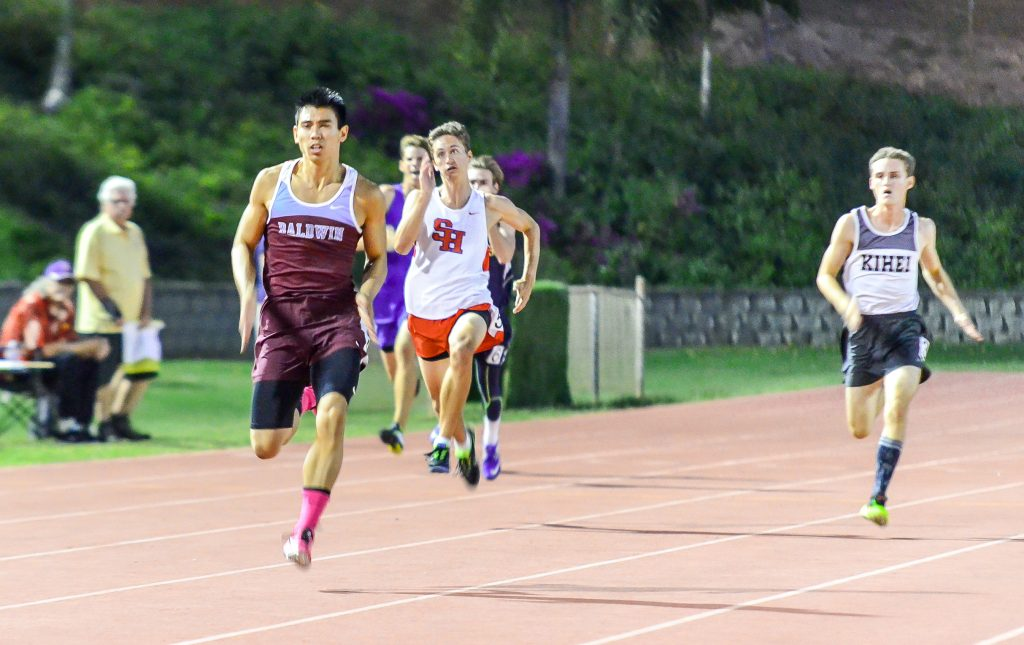 Baldwin's Bailey Kaopuiki blows the competition away in his heat of the 200-meter dash Friday. The Baldwin sprinter was timed in 21.92 seconds to lead all qualifiers. Photo by Rodney S. Yap.