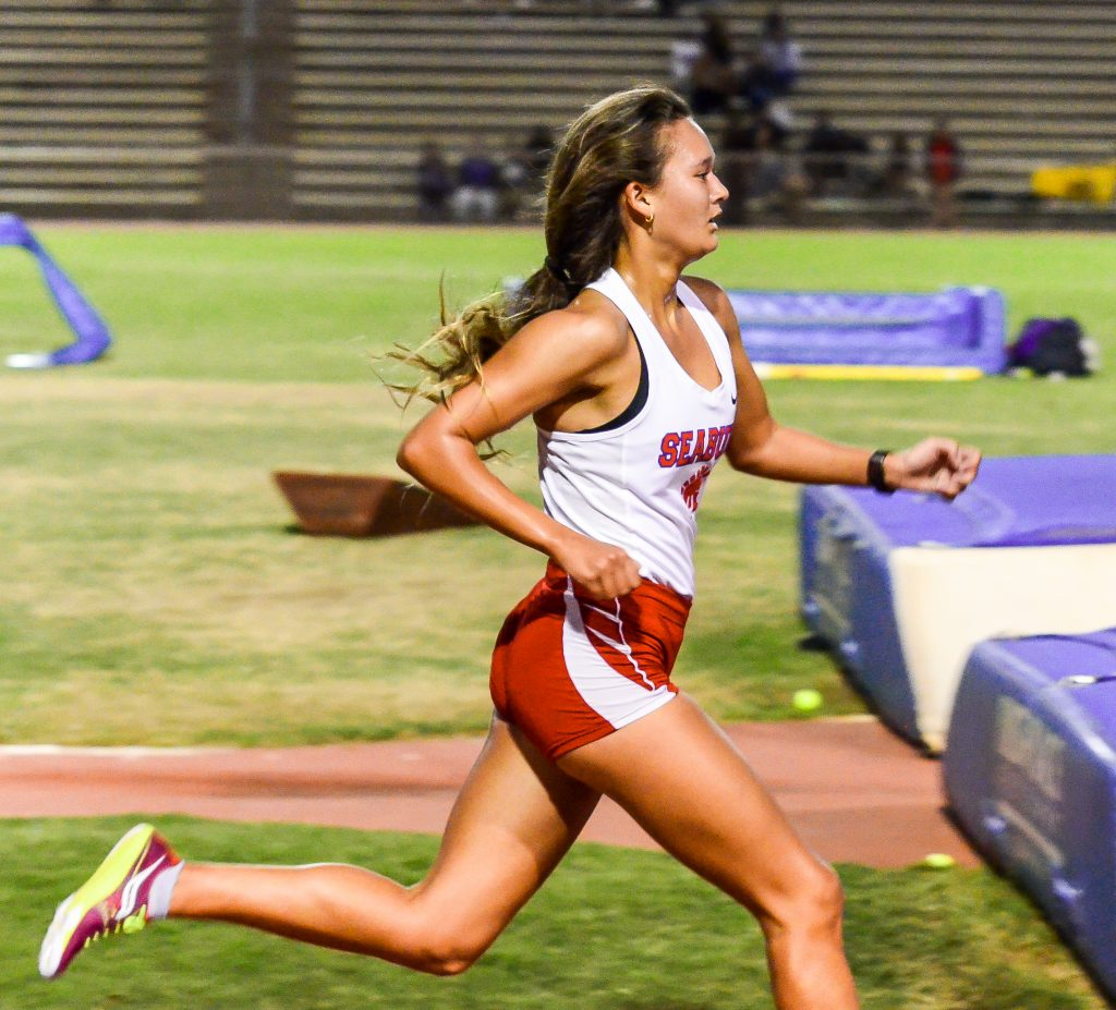 Seabury Hall's Ava Shipman runs to the finish line of the girls 3000 run Saturday. Photo by Rodney S. Yap.