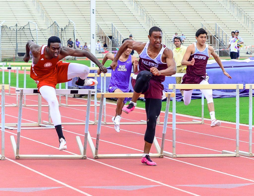 Baldwin's La'akea Kahoohanohano-Davis comes off the final hurdle and races to the finish line to beat Lahainaluna's Kamal Golaube Saturday at Yamamoto Track & Field Facility. Photo by Rodney S. Yap.