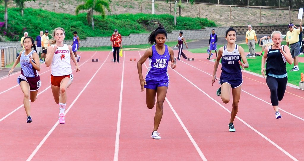 Maui High freshman Alyssa Mae Antolin runs to a first-place finish in the girls 100-meter dash Saturday. Photo by Rodney S. Yap.