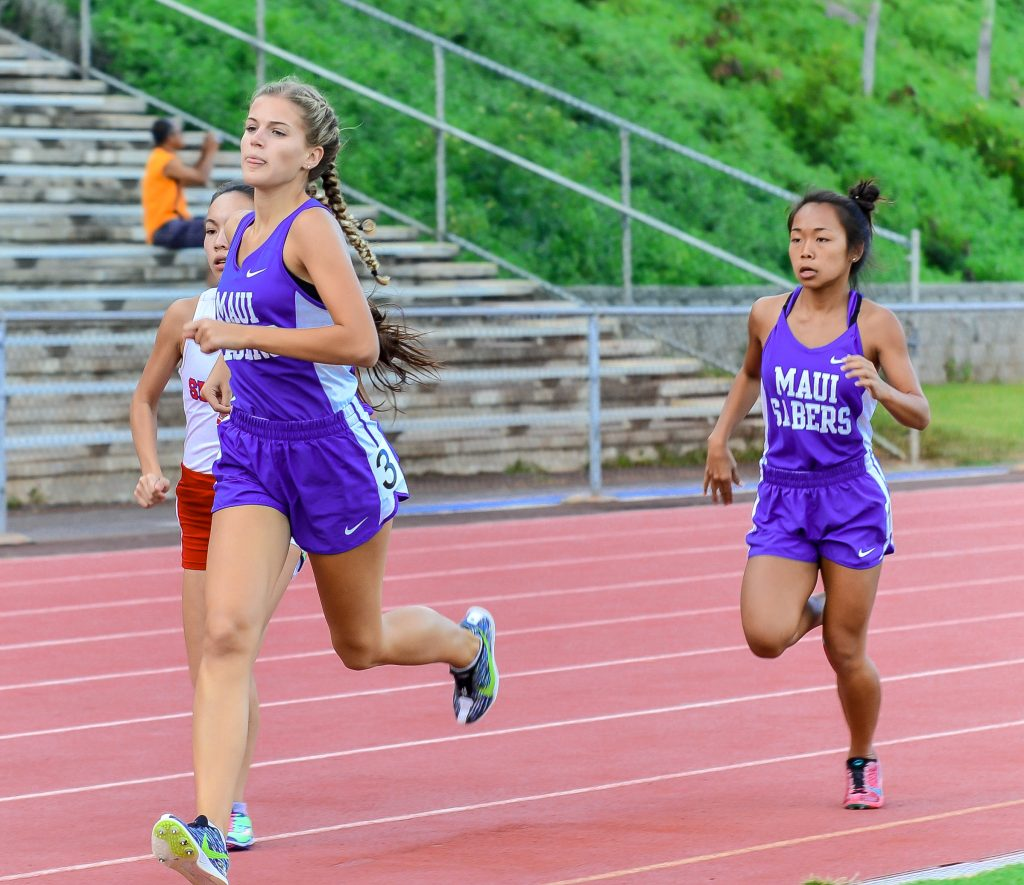 Maui High's Emily Craig and teammate Jules Giron finished second and fourth, respectively, in the girls 1500-meter run Saturday. Photo by Rodney S. Yap.