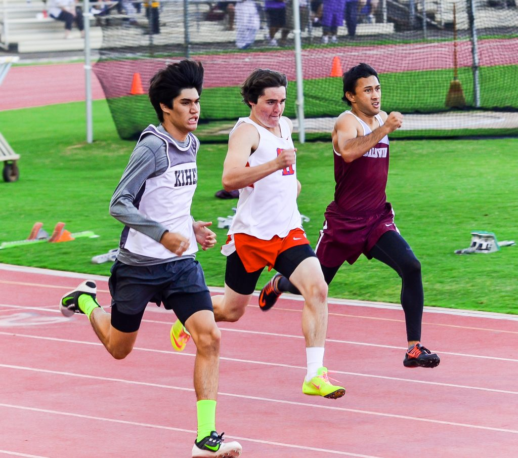 Kihei Charter's Justice Crozier held this lead to win the 400-meter dash Saturday against Seabury Hall's Cole Christie and Baldwin's Kainalu Marquez. Photo by Rodney S. Yap.