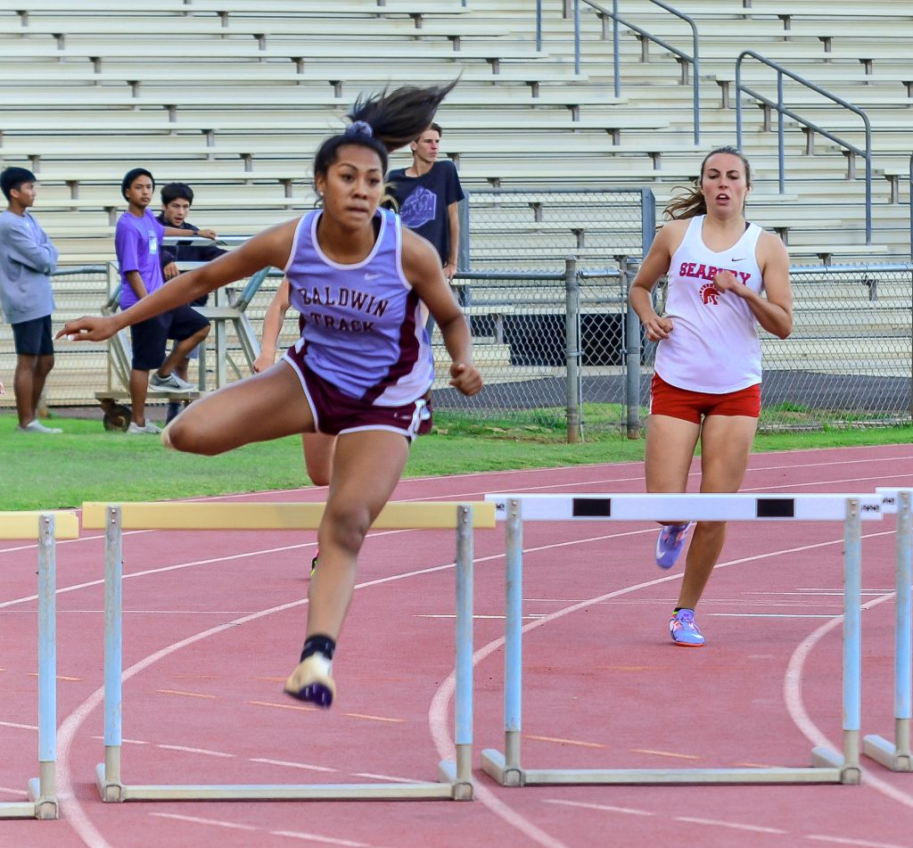 Baldwin's Kacy-Lyn Navarro won the girls 300 hurdles. Photo by Rodney S. Yap.