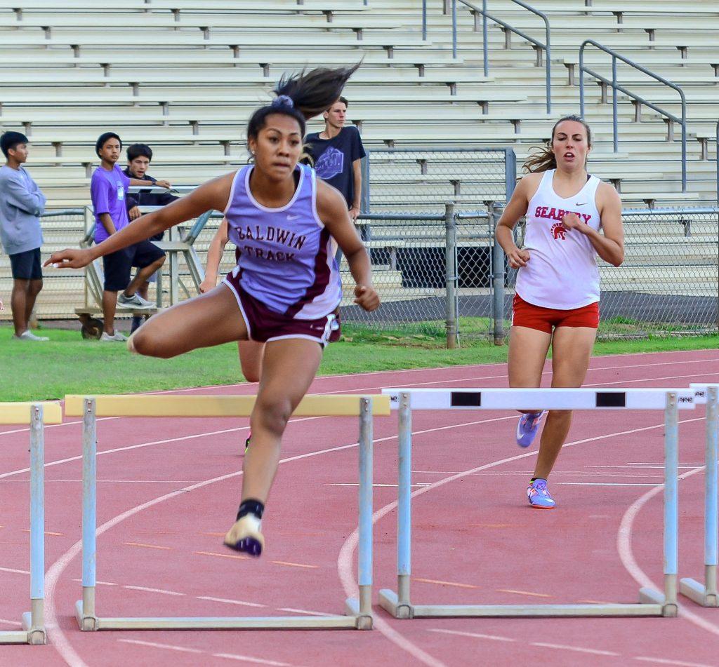Baldwin's Kacy-Lyn Navarro won the girls 300 hurdles. Photo by Rodney S. Yap.