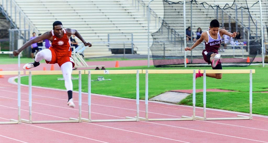 Baldwin's Kiernan Leighton Mateo (right) won Saturday's 300-meter hurdles battle with Lahainaluna's Kamal Golaube. Mateo returned to the track after a five-week layoff. Photo by Rodney S. Yap.