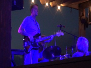 Kona Storm plays in blue light at Fleetwood's on Front Street in Lahaina. Photo by Kiaora Bohlool.