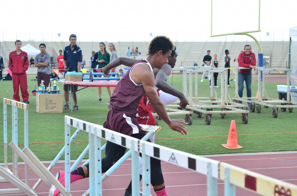 This 11-shot sequence by photographer Glen Pascual shows Baldwin High School's La'akea Kahoohanohano-Davis' attempt to push down the last hurdle in the 110-meter high hurdle race Saturday in the finals of the Victorino Ohana Invitational. But instead of going to the ground, the hurdle bounces back up and wraps itself around Kahoohanohano-Davis as he tries to finish the race. Photo by Glen Pascual.