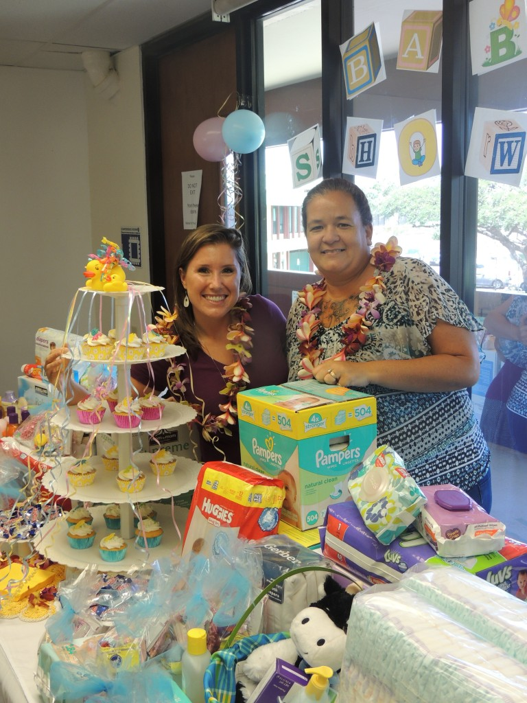 "The Maui County Office on Aging had a ""Baby Shower"" themed staff meeting to benefit local nonprofit Mālama Family Recovery Center. Image: Frances Duberstein and Christine Sa'u. Photo credit: Frances Duberstein."