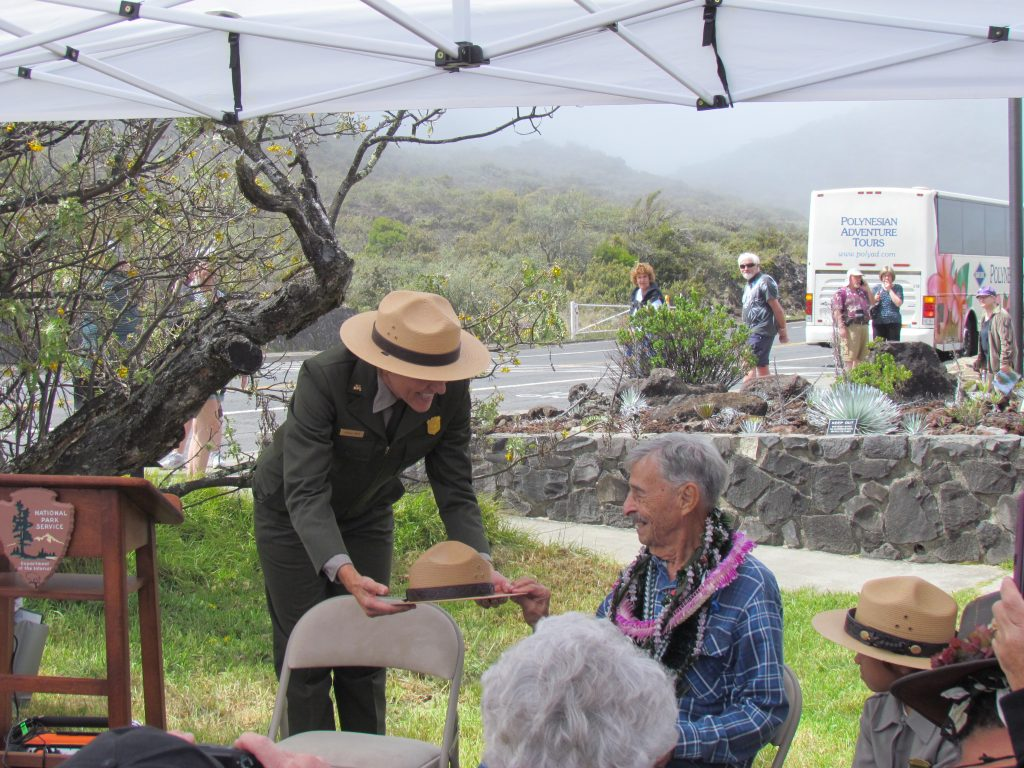 Superintendent Gates presenting Uncle Rex Ornellas with a ranger hat. Photo courtesy Haleakalā National Park.