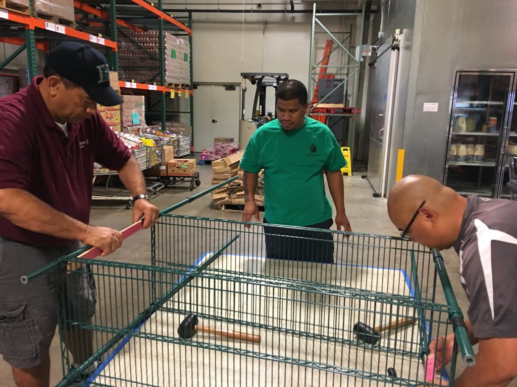 Xerox Maui employees and their family members spent Saturday constructing much needed shelving units at the Maui Food Bank. Photo 4.23.16 Credit: Xerox Maui.