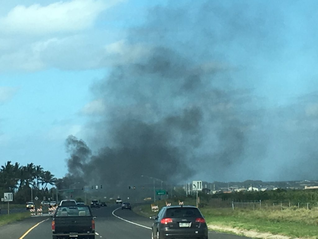 Fire Burns Abandoned Vehicles in Vacant Kahului Field. (4.18.16) Photo credit: Kaimana Nakamura.