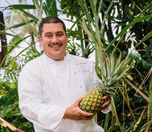 Westin Maui Resort Executive Sous Chef Ikaika Manaku sources local produce, including Maui Gold pineapples. Westin Maui photo.